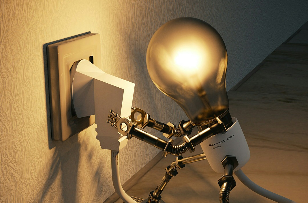 Light bulb plugging itself in to give more light.